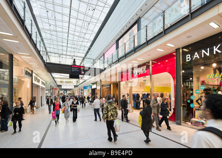 Shops and stores in the Arndale Centre, Manchester, England - Stock Photo
