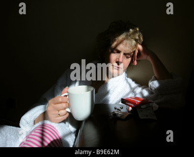 Middle aged woman suffering from depression posed by model - Stock Photo