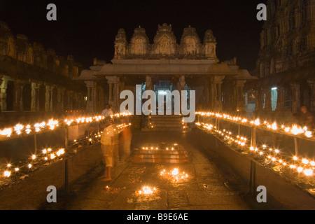Oil lamps burning in a temple, Hampi, Karnataka, India - Stock Photo