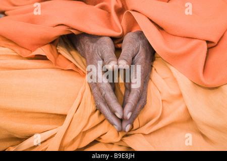 Mid section view of a sadhu praying, Varanasi, Uttar Pradesh, India - Stock Photo