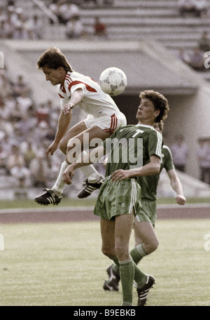 Torpedo Moscow player Yuri Savichev right and Dnepr halfback Nikolai Kudritsky left are fighting for the ball during - Stock Photo