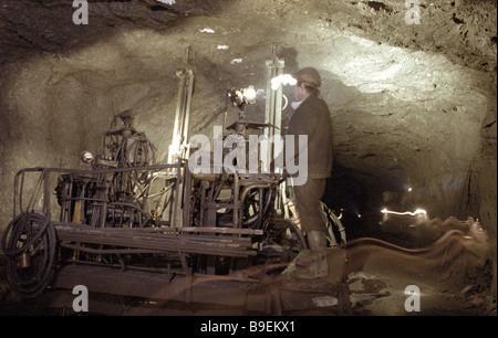 A miner at the Vorkuta coal basin working in a mine - Stock Photo