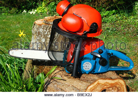 Chainsaw and safety helmet, Dorset, England, UK - Stock Photo