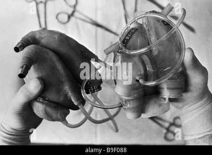Artificial hearts made in the USSR left and the USA right Moscow Research Institute of Transplantation and Artificial - Stock Photo