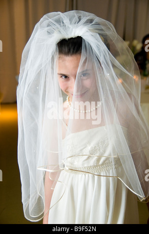 A girl in a wedding veil - Stock Photo