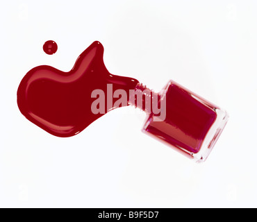 Nail polish red vial fallen runs out Beauty cosmetics cosmetics-articles glass-bottle opened nail polish-vial poured - Stock Photo