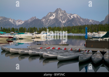 Pre-sunrise view of Mount Moran and the still surface of Jackson Lake in Colter Bay Marina, Grand Teton National - Stock Photo