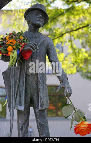 Germany Bavaria Munich Karl-Valentin-fountain Viktualienmarkt Bavaria known famous sculpture sculptor-art flower - Stock Photo