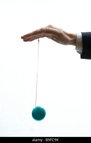 Close-up of person playing with yo-yo - Stock Photo