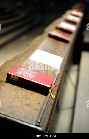 Hymnbooks on pew in church, Bohemia, Prague, Czech Republic - Stock Photo