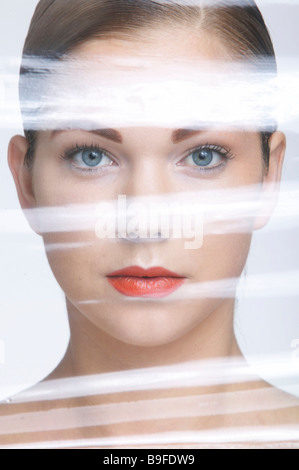 Portrait of young woman undergoing plastic surgery - Stock Photo