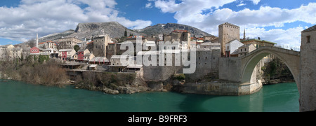 Panorama of Mostar old town east side with the Old Bridge on a sunny winter day. - Stock Photo