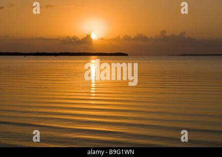 Sun rises through clouds over mangrove islands in Florida Bay Everglades National Park Florida - Stock Photo