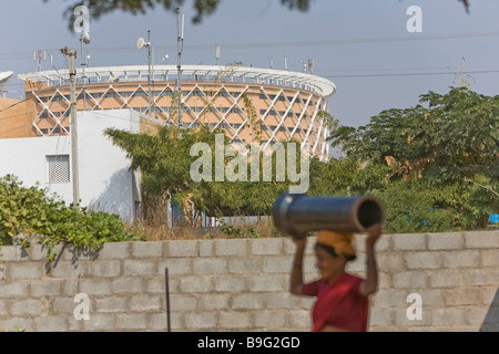 India Hyderabad Hi Tech city Worker In the background Cyber Towers - Stock Photo
