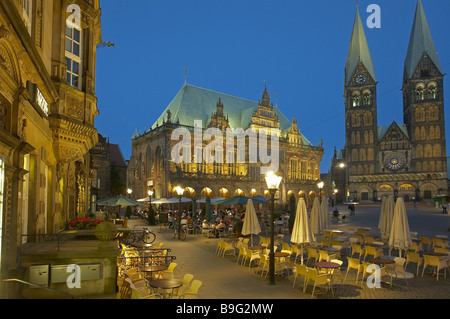 Germany Bremen market place street-pubs town hall facade St. Petri cathedral evening - Stock Photo