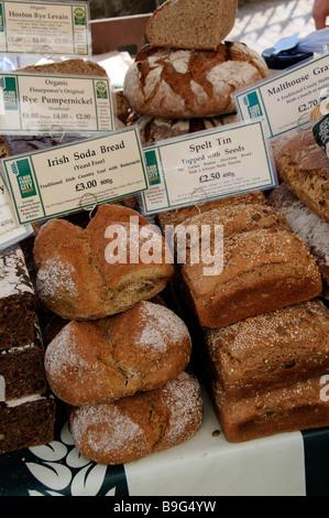 Fresh bread on sale on a farmers market stall in Royal Tunbridge Wells Kent England UK - Stock Photo