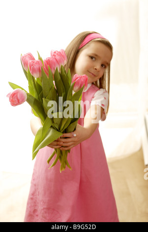 5-8 years gaze camera flowers flower-bouquet detail color-mood pink cheerfully spring spring-flowers spring-bouquet - Stock Photo