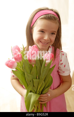5-8 years gaze camera flowers flower-bouquet color-mood pink cheerfully spring spring-flowers spring-bouquet gift - Stock Photo