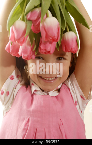 5-8 years broached gaze camera flowers flower-bouquet color-mood pink cheerfully spring spring-flowers spring-bouquet - Stock Photo