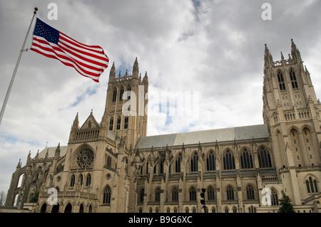 The Washington National Cathedral In Washington DC with US flag - Stock Photo