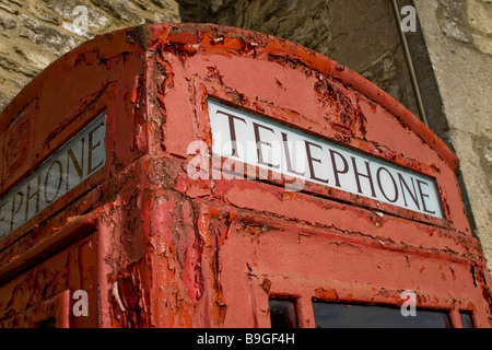 Old and rusty red telephone box in Wolverton, near Bath. - Stock Photo
