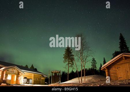 Aurora borealis or northern lights moving across night sky Winter basecamp Oulanka National Park Oulu Lapland Finland - Stock Photo