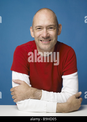 Man bald head smiling cheerfully portrait series people kindly balance contentment joy happily sitting waits protests - Stock Photo