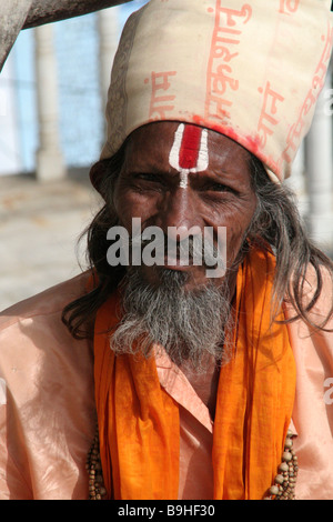 Saddhu in saffron robes in Mumbai - Stock Photo