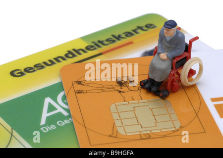 Policy holder-cards figure senior wheelchair no property release health insurance company legally health illness - Stock Photo