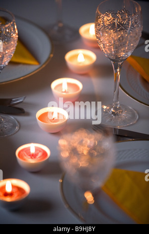Table covered glasses candles detail - Stock Photo