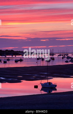 A colourful dusk over the sailing boats moored in Conwy Bay viewed from Conwy Bridge, North Wales, United Kingdom - Stock Photo