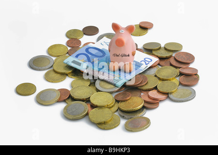 Lucky pig on euro coins and 20 euro bill - Stock Photo