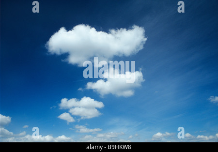 Cumulus and cirrostratus clouds in the blue sky - Stock Photo