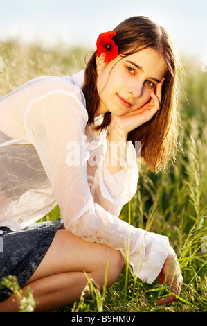 With Red Poppy in Hair - Stock Photo