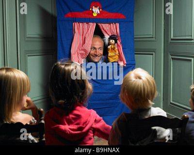 Kids watching a puppet show - Stock Photo