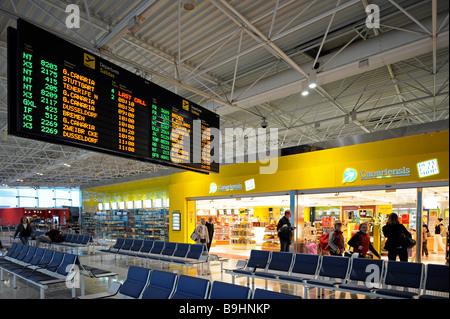 Duty-Free Shop and a departure board in the waiting area at a boarding gate, Fuerteventura Airport, Canary Islands, - Stock Photo