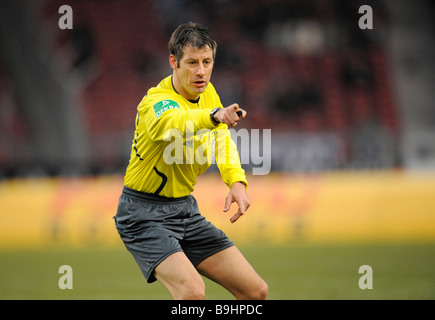 Wolfgang Stark referee indicating to continue the game - Stock Photo
