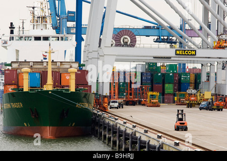 Container ship being unloaded in the port of Rotterdam, the Netherlands, Europe - Stock Photo