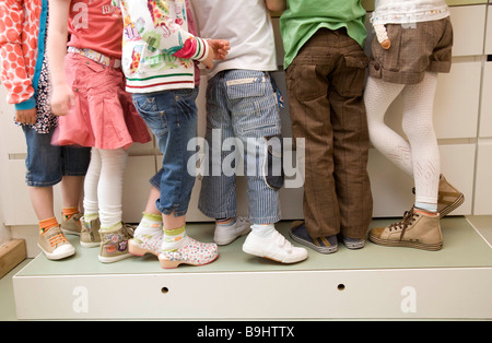 Six pair of girls and boys legs - Stock Photo