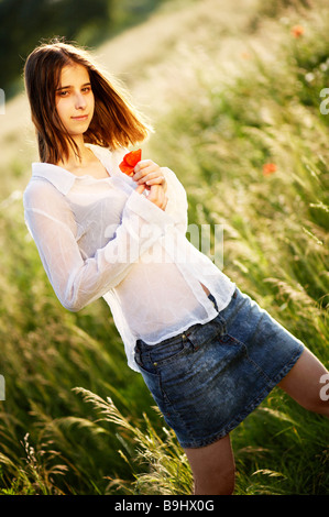 With Red Poppy in Hand - Stock Photo