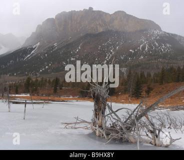 Frozen lake under Mount Yamnuska near Canmore, Alberta - Stock Photo