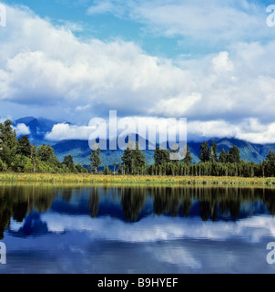 Matheson Lake with reflection on surface, Southern Alps, South Island, New Zealand - Stock Photo