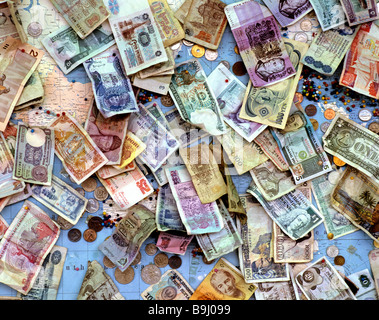 Old banknotes and coins, international currencies, global currencies - Stock Photo
