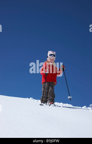 Little girl skiing on mountain - Stock Photo