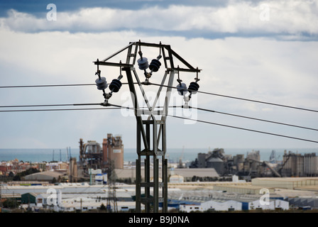 View of power line with industrialised Spanish coastline of the Costa Blanca in the background Region of Valencia - Stock Photo
