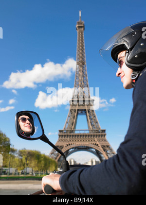Man on moped in Paris - Stock Photo