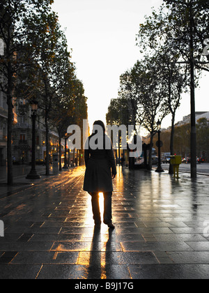 Woman walking on Champs Elysees - Stock Photo