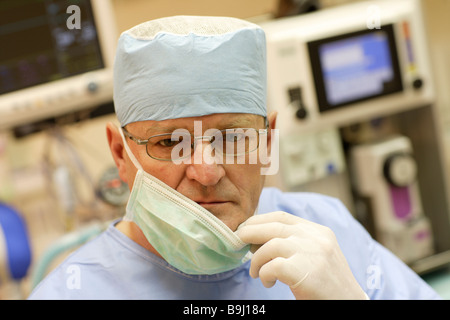 Doctor wearing surgical mask in the operating room - Stock Photo