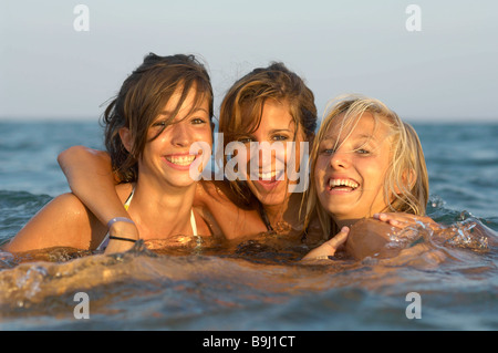 Girls teenagers playing in the sea - Stock Photo