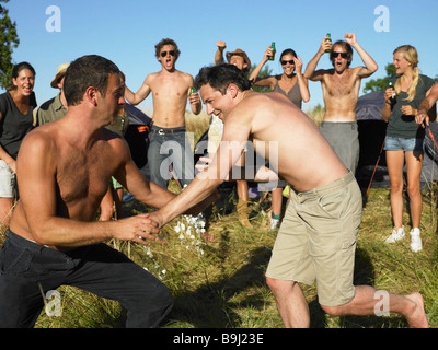 Men fighting,  supporting crowd - Stock Photo